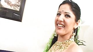Parro is a hot Indian princess who loves to fuck Shes never been on camera before but shes anything but shy When shes joined by Jon Janeiro there is an instant attraction Shes not wearing anything underneath that hot green outfit and Jon couldnt be happier He lifts it up and immediately makes his way down to her foreign pussy He licks his way all around her cunt while she moans and squirms with delight He doesnt want to waste much time with foreplay so after briefly sucking the shit out his massive cock he crams her Indian muff full of American man meat