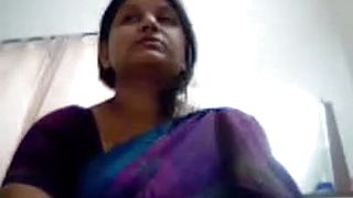 Watch this beautiful Indian woman showing her huge assets and body on webcam with her husband